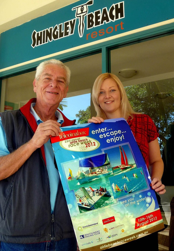President of WSC Jeff Brown with Charmaine Trundle, assistant manager of Shingley Beach Resort, set about displaying posters. Photo: Bob Feeney - Telcoinabox Airlie Beach Race Week 2012 © Whitsunday Sailing Club