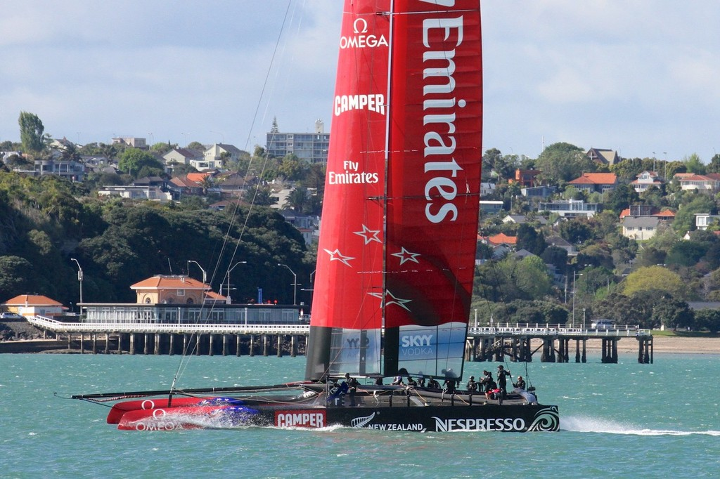 Emirates Team NZ's AC72 slides past Orakei Wharf on her way to start the tenth day of sailing since launch © Richard Gladwell www.photosport.co.nz