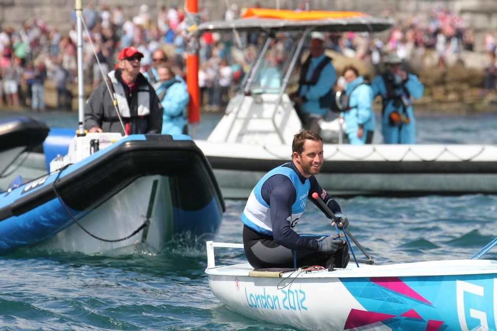 August 5, 2012 - Weymouth, England - Ben Ainslie leaves the Nothe folowed by his long-time coach, David Howlett © Richard Gladwell www.photosport.co.nz