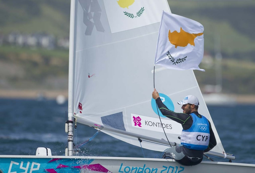 Pavlos Kontides (CYP) who won the Silver Medal today, 06.08.12, in the Medal Race Men's One Person Dinghy (Laser) event in The London 2012 Olympic Sailing Competition. © onEdition http://www.onEdition.com