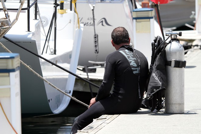 A diver takes a moment's respite from the rigours of hull cleaning at the CYCA. - Rolex Sydney Hobart Yacht Race ©  Alex McKinnon Photography http://www.alexmckinnonphotography.com