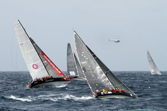 Sailors with Disability, Southern Exposure and KLC Bengal 7 battle it out - Rolex Sydney to Hobart ©  Alex McKinnon Photography http://www.alexmckinnonphotography.com