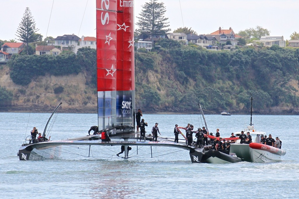 Checking out the undercarriage - Emirates Team NZ - 26 February 2013 © Richard Gladwell www.photosport.co.nz