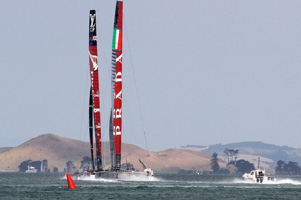 Emirates Team NZ gets through to windward and ahead of Luna Rossa as they near the first turning mark - March 8 2013, ETNZLR - - AC72 Race Practice - Takapuna March 8, 2013 © Richard Gladwell www.photosport.co.nz