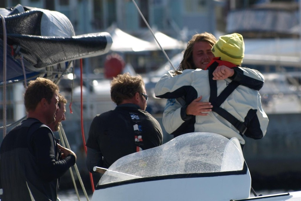 Peter & Sean Langman embrace - New Sydney Hobart passage record holder Team Australia - blasts home © Jane Austin