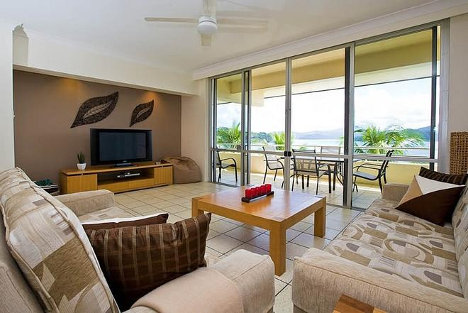 Enjoy the beautiful open plan design that Frangipani 204 offers directly opposite the beach! © Kristie Kaighin http://www.whitsundayholidays.com.au