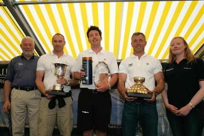The crew from 5 West, the 2013 winners of the Gold Roman Bowl. <br /> <br /> Jonathan Taylor, Alex Mills, Robert Greenhalgh are flanked by left, Sir Robin Knox-Johnston and on the right, Corrie McQueen from J.P. Morgan Asset Management - 2013 Round the Island Race &copy; Patrick Eden