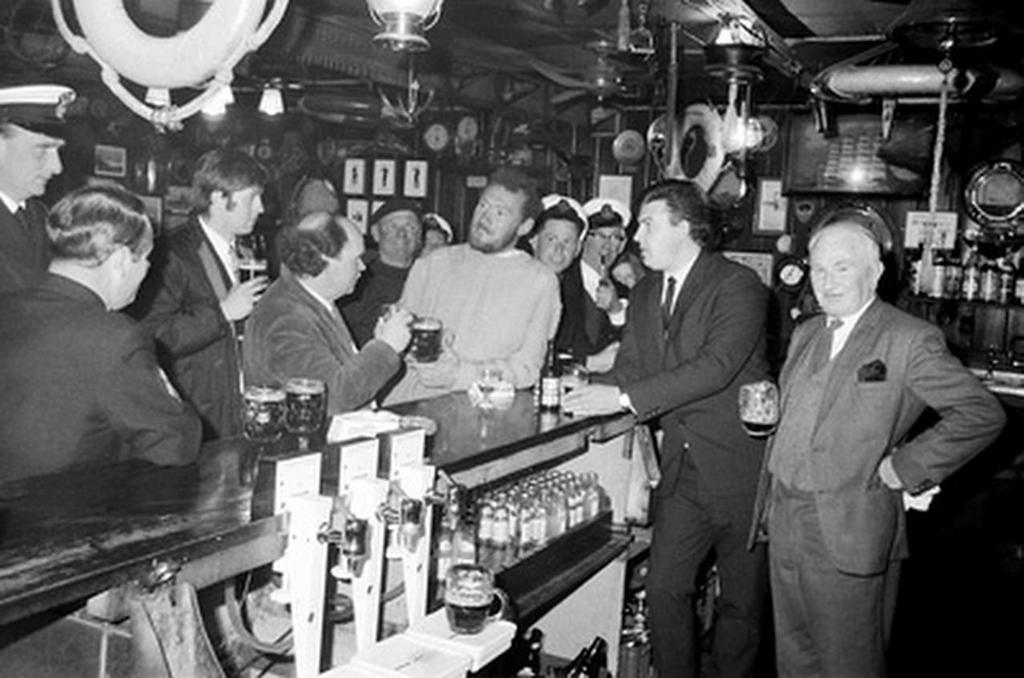 Circa 22nd April 1969: Robin Knox-Johnston regailing friends with stories of his solo circumnavigation, in the bar of the Royal Cornwall Yacht Club after becoming the first man to sail solo non-stop around the globe. Knox-Johnston was the sole finisher in the Sunday Times Golden Globe solo round the world Falmouth, England on 14th June 1968 © Bill Rowntree - PPL http://www.pplmedia.com