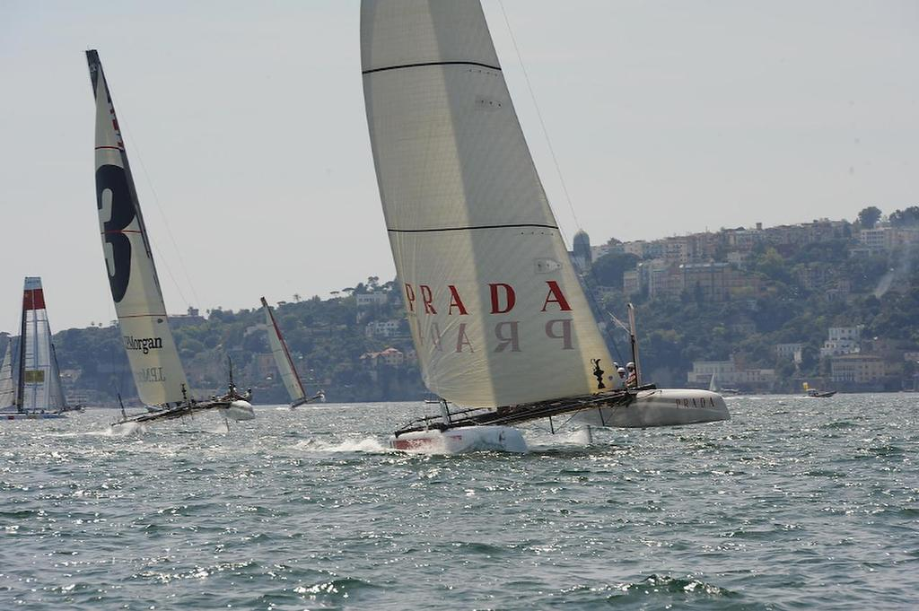 Chris Draper skipper for Luna Rosa is coming off the start in a first place position at speeds of more than 25 knots toward the leeward gate at the ACWS official practice race on the Bay of Napoli in Italy.  ©  SW