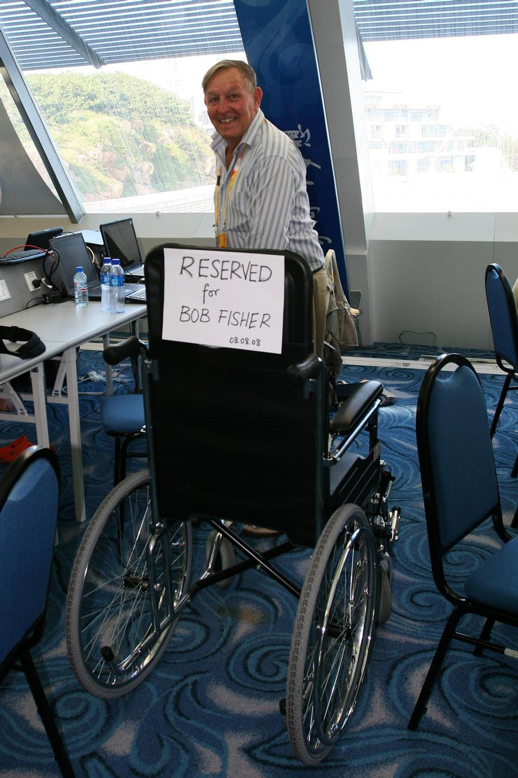 Happy Birthday Fish - need that wheelchair yet? Of course not!  Qingdao, 2008 © Guy Nowell http://www.guynowell.com