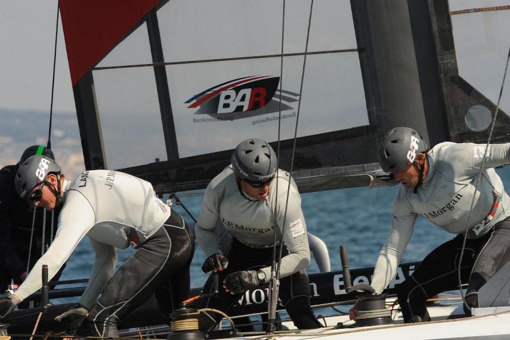 Kyle Langford, wing trim, Matt Mitchell, runner, and Simon Daubney, trimmer, bring J.P.Morgan Bar  through the windward gate and on to placing first in the second race at the ACWS in Naples Italy on April 18, 2013. ©  SW