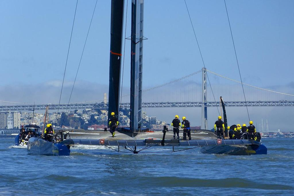 Tow out - Artemis Racing - Blue Boat - First Sail, July 24, 2013 © John Navas