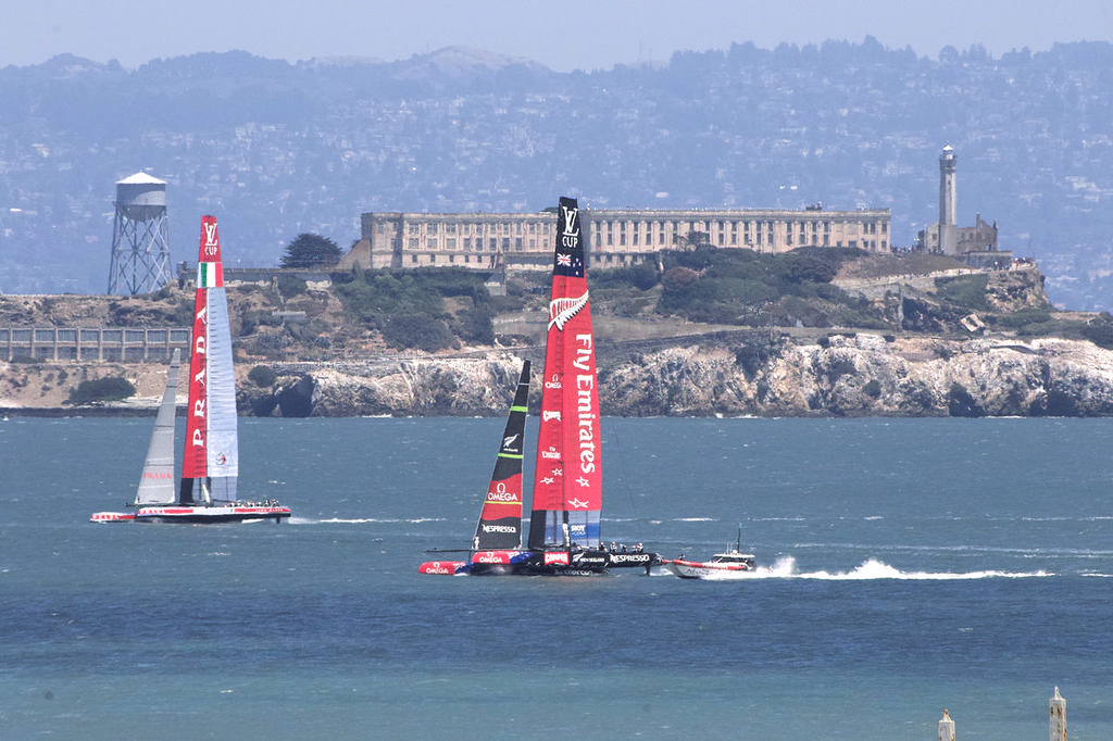 Prada and ETNZ, sailing upwind with Alcatraz Island in the background.   - America's Cup © Chuck Lantz http://www.ChuckLantz.com