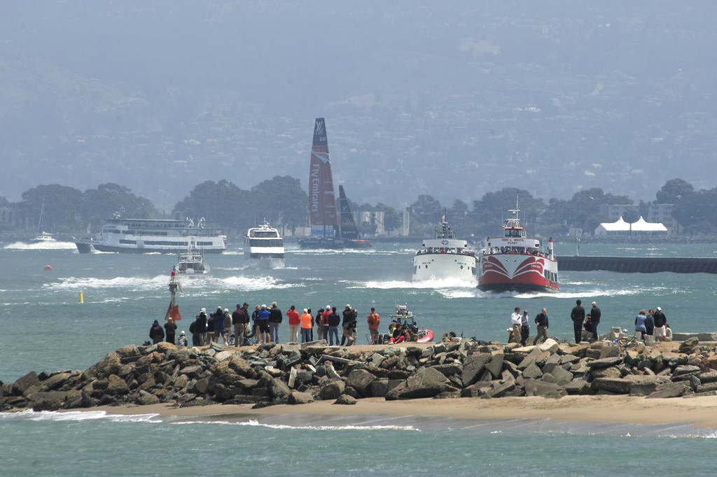 ETNZ hits the finish line as spectators watch from the spit near the Golden Gate YC.  - America's Cup © Chuck Lantz http://www.ChuckLantz.com