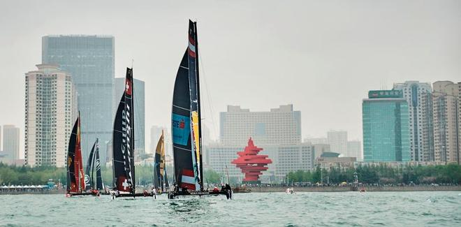 2016 Act 2, Qingdao - The fleet race in front of May Fourth Square – The countdown is on as the teams prepare to take to the water for the second Act of the 2017 Extreme Sailing Series™ in China's Olympic Sailing City in one week's time. © Aitor Alcalde Colomer