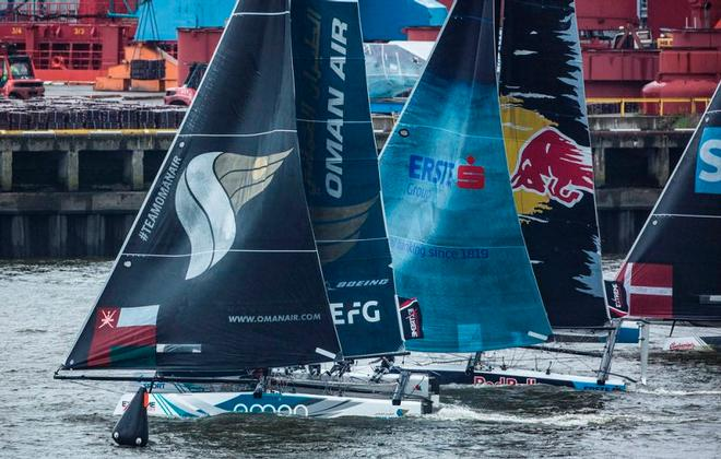 Act 5, Extreme Sailing Series Hamburg – Day 3 – Oman Air maintained its lead while Red Bull Sailing Team climbed from bottom of the table to second after seven nail-biting races. ©  Lloyd Images