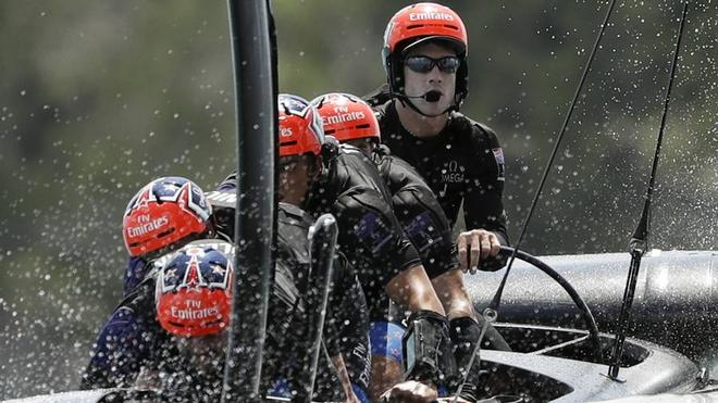 Peter Burling steers Team New Zealand during the America's Cup. © SW