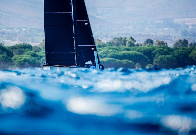 Day 1 – 'Boat disappearing' waves were a feature of the racing today – GC32 Orezza Corsica Cup © Jesus Renedo / GC32 Racing Tour