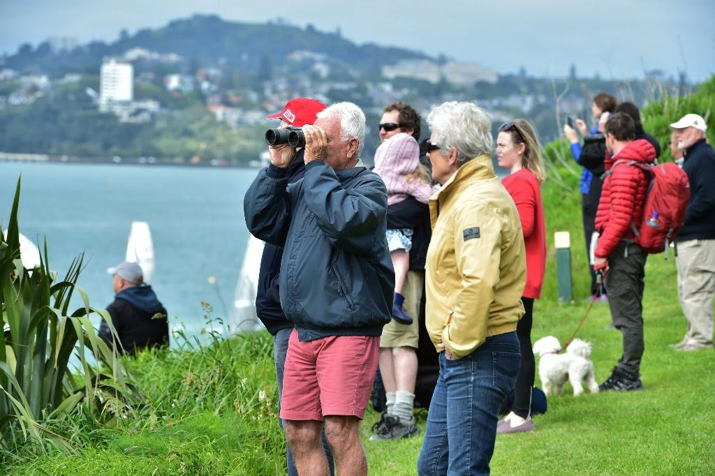 Crowds watch on North Head - a Labour Weekend tradition in all weather - PIC Coastal Classic 2017 © Ivor Wilkins