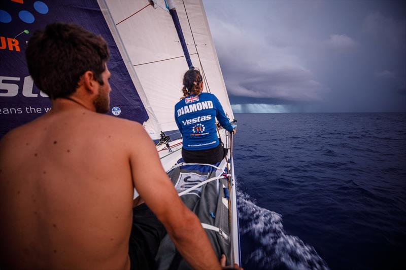 Leg 4, Melbourne to Hong Kong, day 11, Hannah Diamond sits on the rail while waiting for whatever trickery the looming rain cloud has in store while on board Vestas 11th Hour. - photo © Amory Ross / Volvo Ocean Race