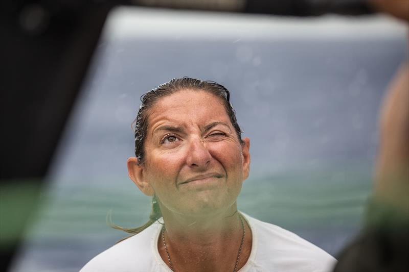 Leg 4, Melbourne to Hong Kong, Day 10 onboard Turn the Tide on Plastic. Dee Caffari leaning a hand during a peel in a morning squall. - photo © Brian Carlin / Volvo Ocean Race