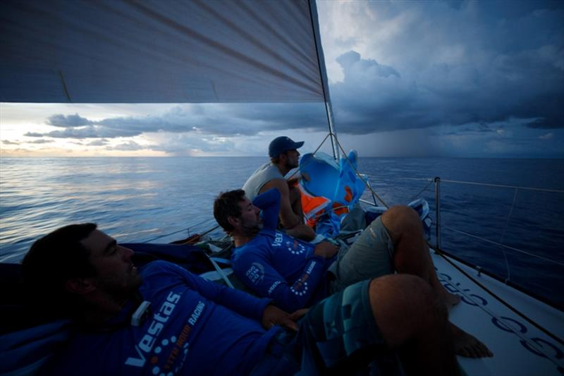 Volvo Ocean Race Leg 4, Melbourne to Hong Kong, day 11, rain clouds line the horizon at sundown while Nick Dana, Simon Fisher `SiFi` and Mark Towill await their influences on board Vestas 11th Hour. photo copyright Amory Ross / Volvo Ocean Race taken at  and featuring the Volvo One-Design class