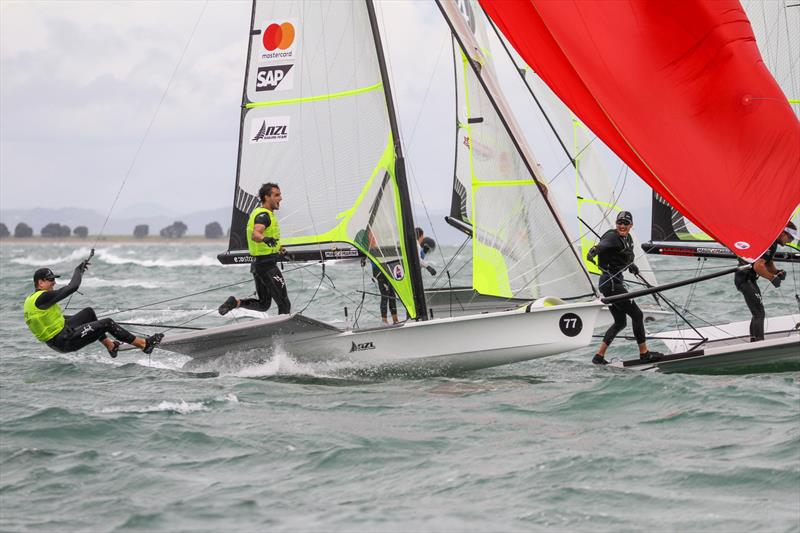 Logan Dunning Beck yells his congratulations to Peter Burling and Blair Tuke just after the two Kiwi crews cross the finsih line in the Medal Race - Hyundai Worlds. December 2019 - photo © Richard Gladwell / Sail-World.com