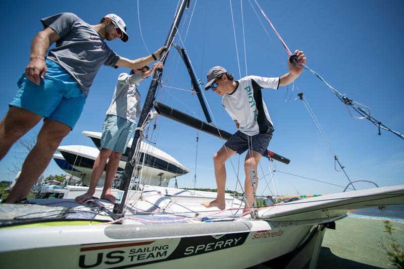 Trainees worked with coach Nate Housberg on rigging a 49er - photo © Lexi Pline