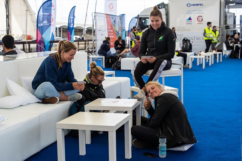 A game of cards filled in time for some of the 49erFX sailors - Genoa World Cup Series 2019 photo copyright Beau Outteridge taken at  and featuring the 49er FX class