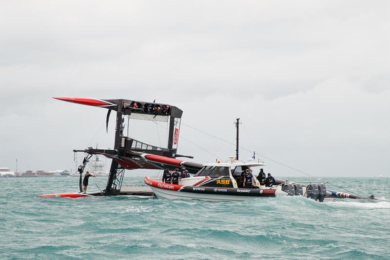 Emirates Team New Zealand capsize on the second day of the Louis Vuitton America's Cup Challenger Playoffs - photo © Richard Hodder / ETNZ