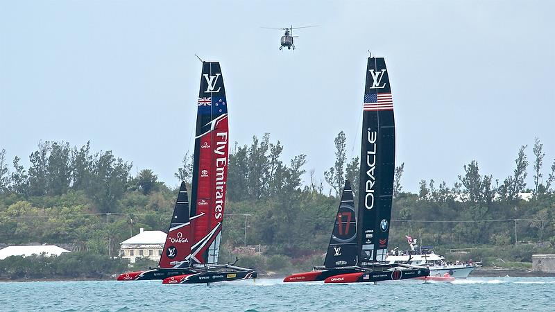 Oracle Team USA works over Emirates Team NZ at the start of Race 12 - Round Robin2, America's Cup Qualifier - Day 8, June 3, 2017 (ADT) photo copyright Richard Gladwell taken at  and featuring the AC50 class