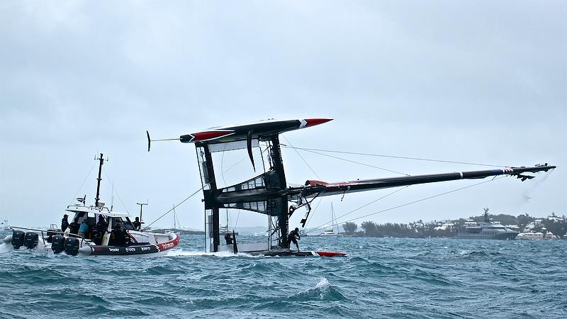 Emirates Team New Zealand - recovery - power goes on from the chase boat and the AC50 starts to come upright - Race 4 - Semi-Finals, America's Cup Playoffs- Day 11, June 6, 2017 (ADT) - photo © Richard Gladwell