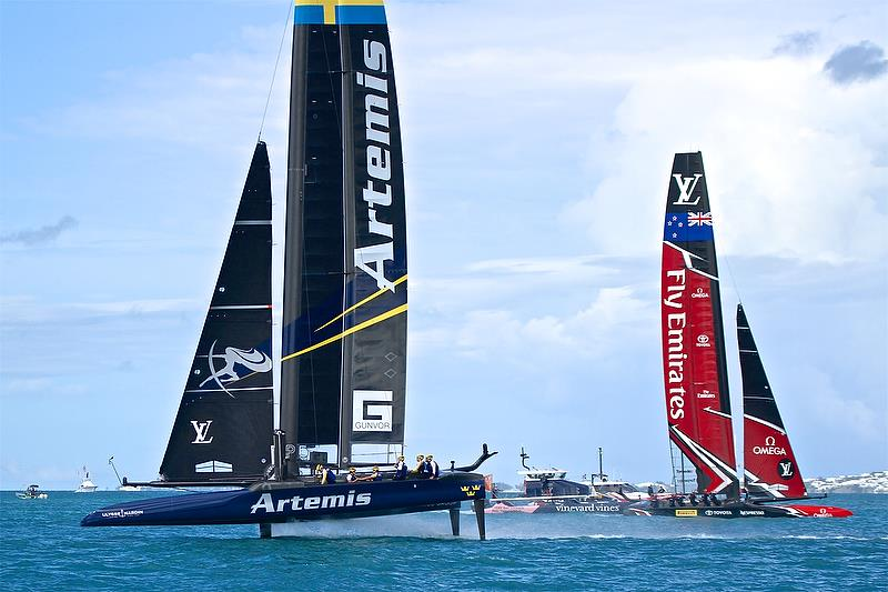Artemis Racing heads for the finish line passing an already finished Emirates Team New Zealand - Race 7 - Finals, America's Cup Playoffs- Day 15, June 12, 2017 (ADT) - photo © Richard Gladwell