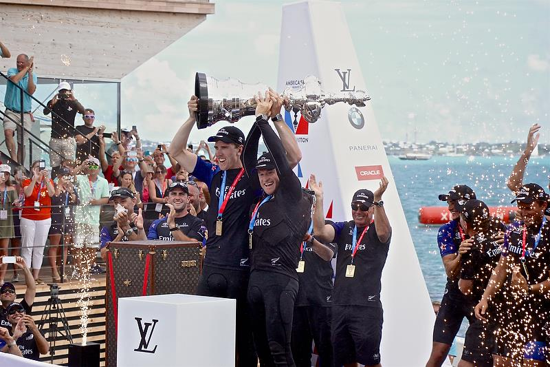 Peter Burling and Glenn Ashby lift the America's Cup for the first time (there was no handover from Golden Gate YC or Oracle Team USA) - photo © Richard Gladwell