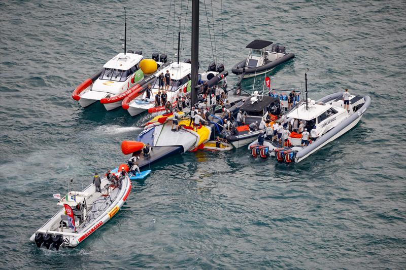 The America's Cup support teams work together to save NYYC American Magic's Patriot after a huge capsize on day 3 of the PRADA Cup - photo © COR36 / Studio Borlenghi