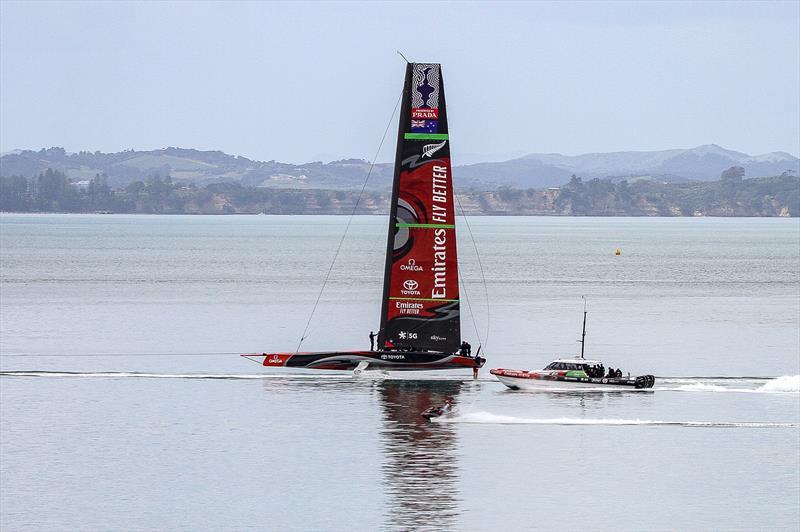 Emirates Team New Zealand under tow in glassy water- chasing the wind further out in the harbour - September 19, 2019. - photo © Richard Gladwell