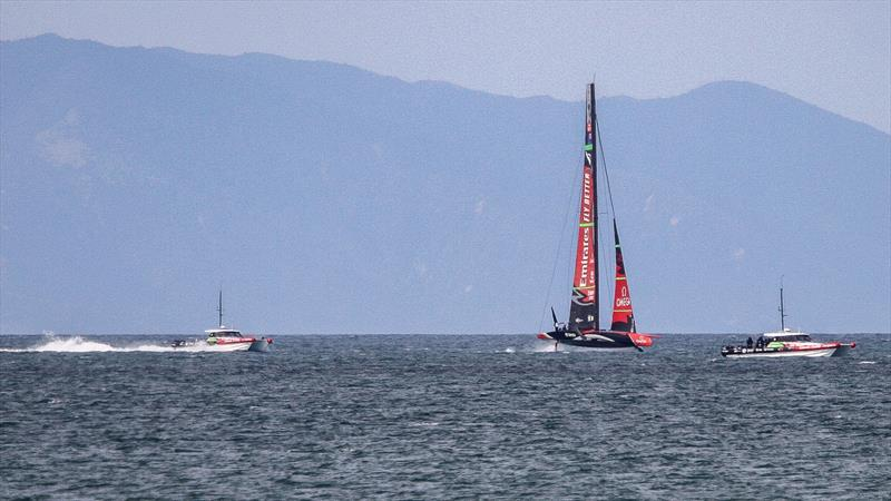 Emirates Team New Zealand makes another run off Rothesay Bay at speed with better yaw control wind conditions probably 18-25kts offshore - with flat water- Waitemata Harbour - September 22 - photo © Richard Gladwell