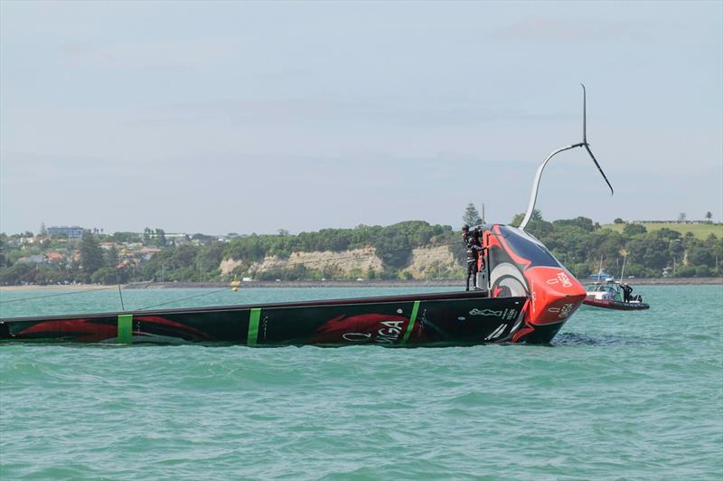 Emirates Team New Zealand in the early stages of being righted with the towline under tension over a chafe pad on the gunnel - Waitemata Harbour - December 19, 2019 - photo © Emirates Team New Zealand