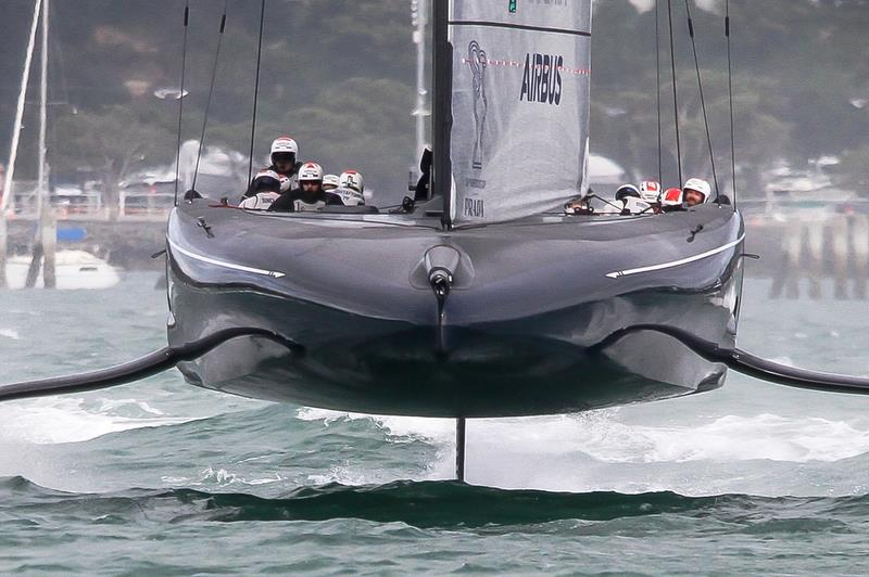 The flat underbody of the scow genre in the AC75 contrasts with the V sections of the skiffs - photo © Richard Gladwell / Sail-World.com