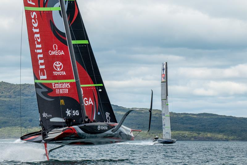 Emirates Team New Zealand and American Magic cross tacks in the Rangitoto Channel - photo © Emirates Team New Zealand