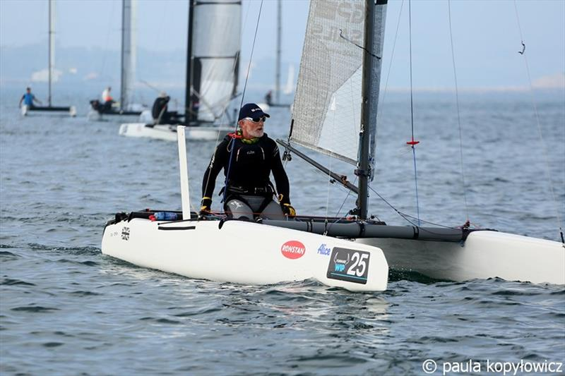 GBR light wind specialist Pete Boxer in his typical downwind pose on day 1 of the A Class Cat Worlds at the WPNSA - photo © Paula Kopylowicz