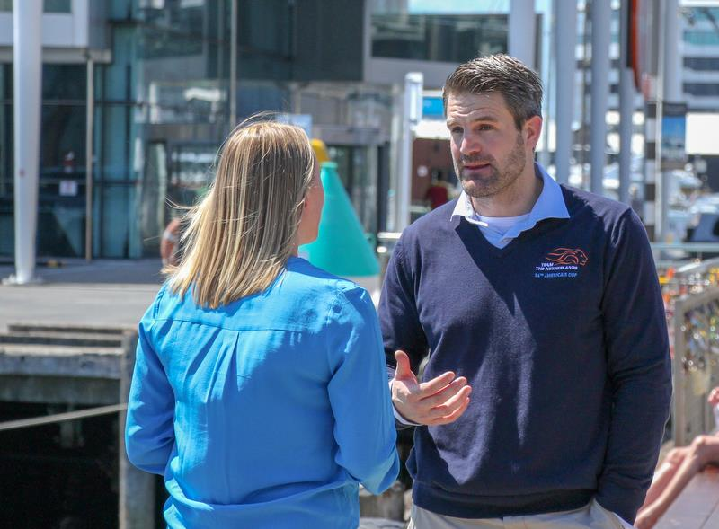 DutchSail's Simeon Tienpont talks with 1News' Abby Wilson - with the Emirates Team NZ base in the background - photo © Richard Gladwell