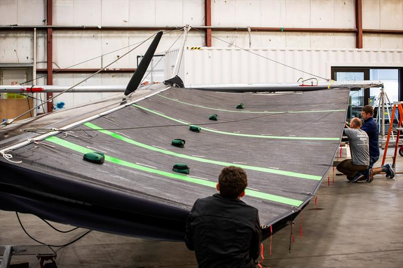 Checking the double-skinned mainsail - American Magic - photo © Amory Ross