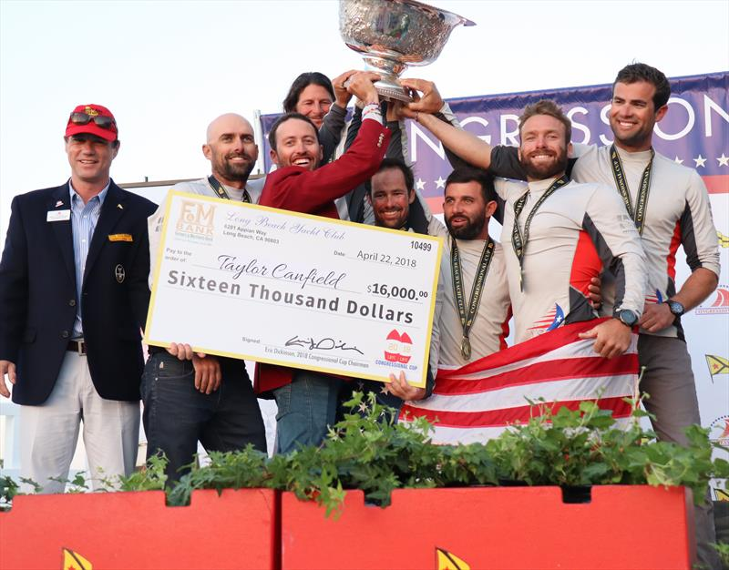 Taylor Canfield hold the winners cheque for the 2018 Congressional Cup. Mike Buckley issecond from right - photo © Bronny Daniels
