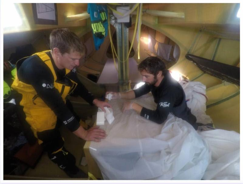 Spinnaker repairs on board Phil Sharp's Class40 Imerys Clean Energy - photo © Imerys