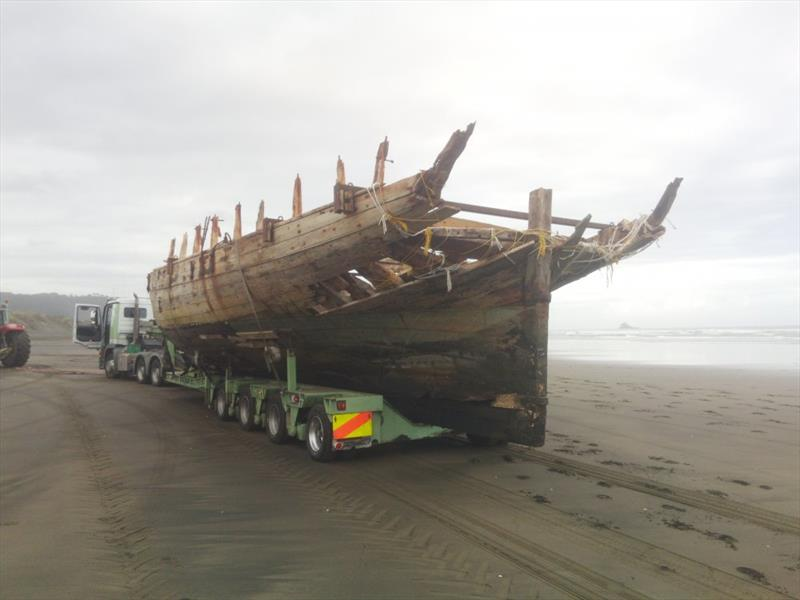 The remains of the 53ft Daring lost in 1865 at the entrance to the Kaipara Harbour are trucked out for restoration - photo © Classic Yacht Charitable Trust