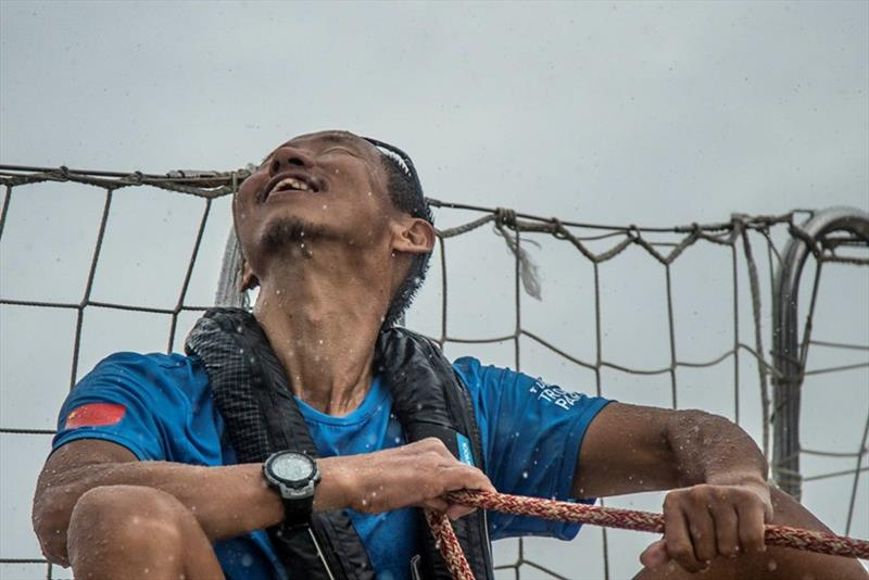Yang smiling in the rain, on board Visit Sanya, China - The Clipper Race Leg 5 - Race 6, Day 17 - photo © Clipper Race
