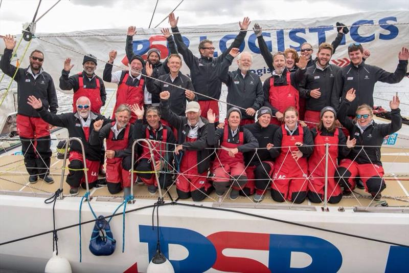Colin (top row, centre) celebrates arriving into Derry-Lononderry after crossing the Atlantic Ocean - photo © Clipper Race