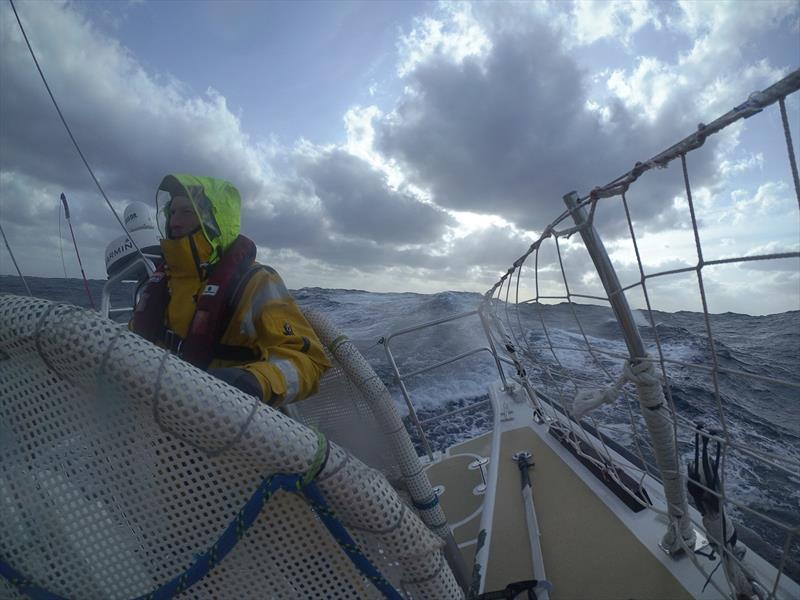 Craig at the helm of Nasdaq during his third North Pacific Ocean crossing! - photo © Clipper Race