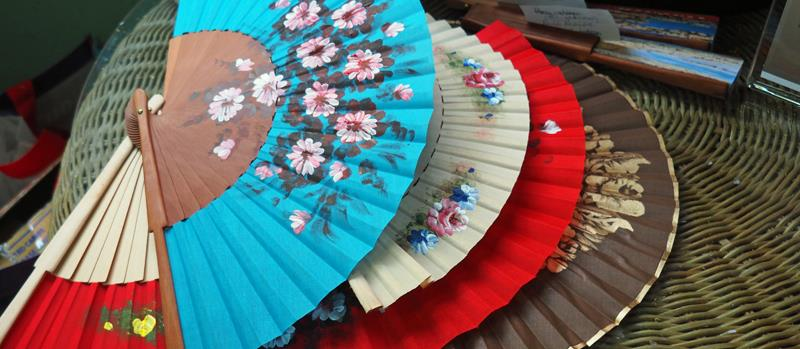 Local crafts - Hand painted fans - Yes we bought one - photo © Neil Langford, SV Crystal Blues